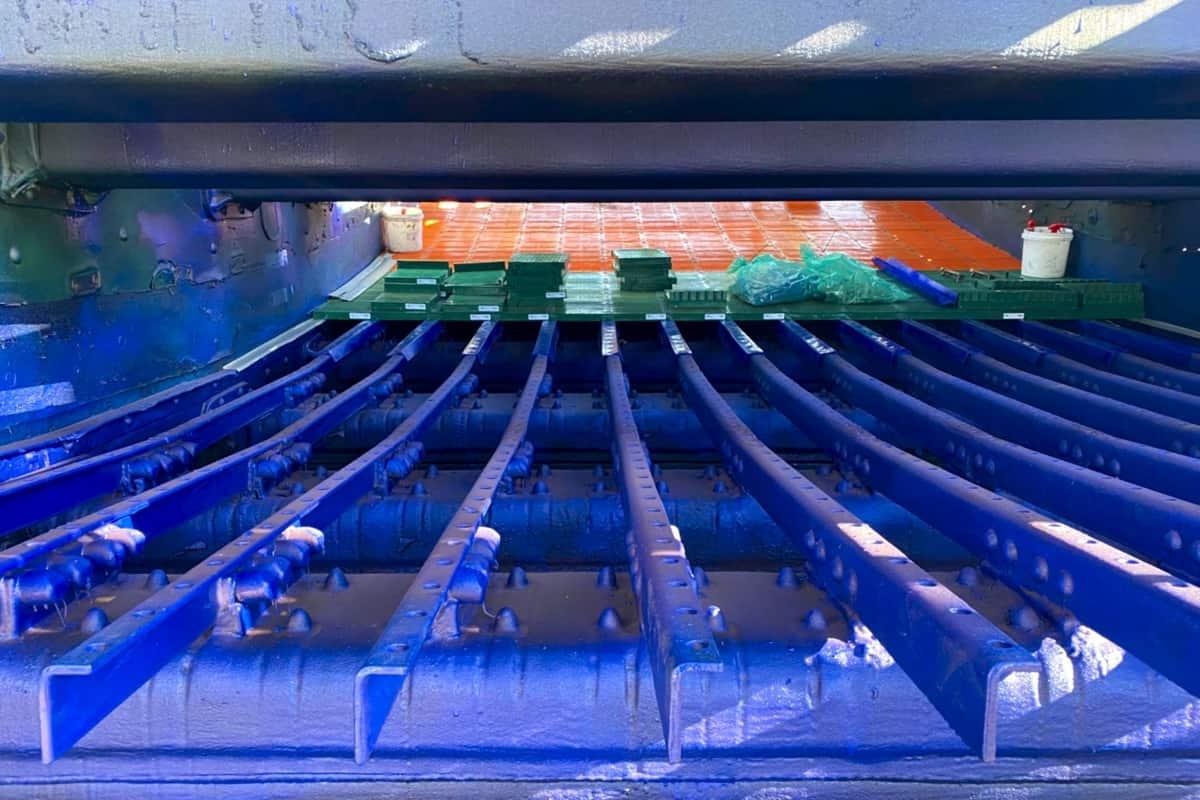 Polyurea coating on a screen deck