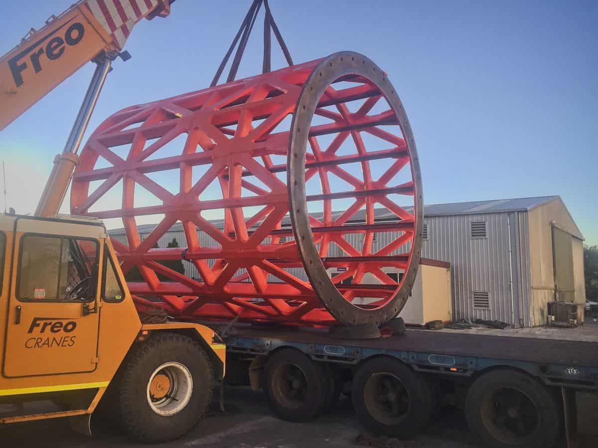 Polyurea coated trommel loading onto a truck